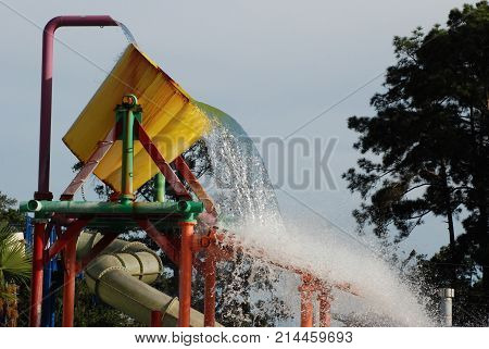 Waterpark feature, a giant splash bucket. When it fills it tilts to spill the contents onto a platform that sends water everywhere.
