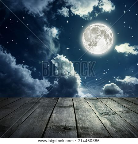 Night sky with stars and full moon wooden planks. Elements of this image furnished by NASA