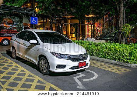 BANGKOK THAILAND - NOVEMBER 04: White vehicle identified as Honda City illegally parks in a handicap parking space in Victoria Gardens in Bangkok on November 04 2017.