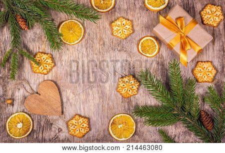Christmas decoration with fir tree pine cones gift pendant and cookies in the shape of snowflakes. Preparing for Christmas