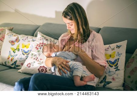 Young Beautiful Mother, Breastfeeding Her Newborn Baby Boy