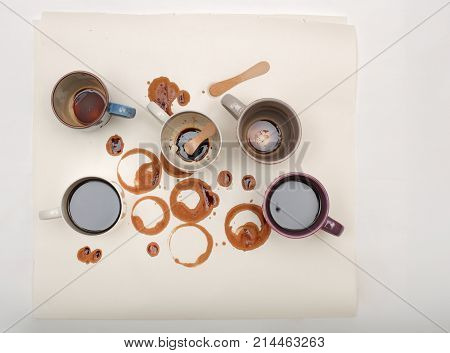 Wet  Coffee Stains And Sticks With Coffee Cups  On White  Paper On White Background