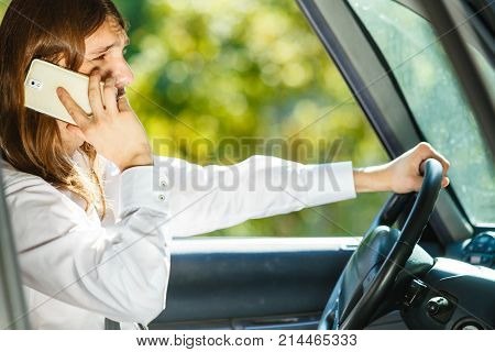 Man Talking On Phone While Driving Car.