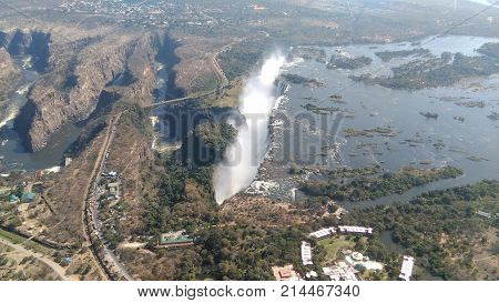 View from the air to the Victoria Falls, border bridge between Zambia and Zimbabwe over a canyon, Zambezi River with bridge, roads and gorges.