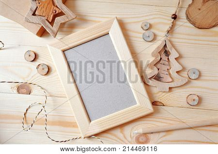 Wooden frame Christmas mockup, stock photography. Design works presentations, for bloggers and social media. Flat lay, top view photo mockup.