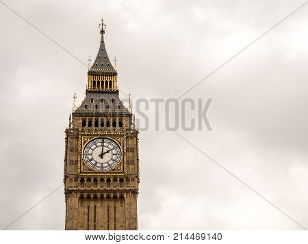 The iconic London landmark Big Ben at 2pm on a grey overcast day; with space for copy.