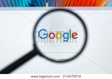 Sankt-Petersburg Russia November 20 2017: Google homepage on the Apple iMac monitor screen under a magnifying glass. Google is world's most popular search engine
