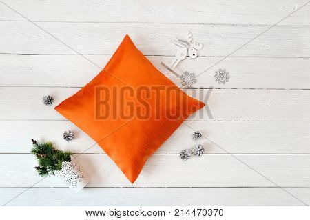 Orange Pillow case Mockup on white wooden background. Flat lay, top view photo mockup. Holidays decorations.