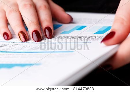 Female arm point finger in financial graph solve and discuss problem closeup. Fresh view at situation board council sale adviser advisor examine profit audit job stock exchange market irs inspector