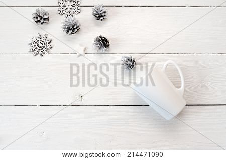 Mockup white mug on a wooden background, in Christmas decorations. Flat lay, top view photo mock up.