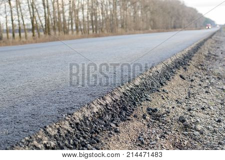 Layer of new laid asphalt road construction close-up