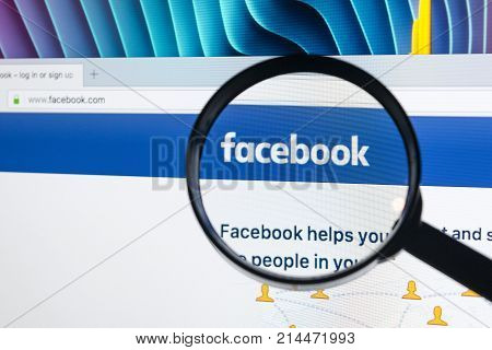 Sankt-Petersburg Russia November 20 2017: Facebook homepage one of the biggest social network website. Homepage of Facebook.com on Apple iMac monitor screen under magnifying glass.