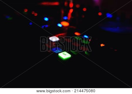 button play with backlight for music mixer DJ large with a dark background