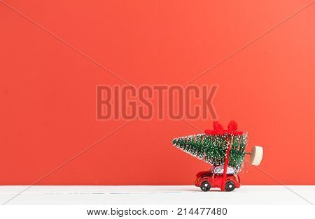 A Toy Car Carries A Christmas Tree