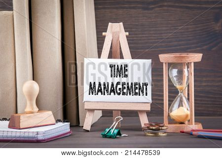 Time management concept. Sandglass, hourglass or egg timer on wooden table showing the last second or last minute or time out