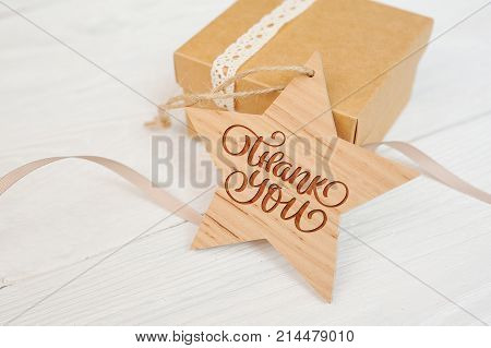 text thank you on wooden star and box, Thanksgiving Day you card.