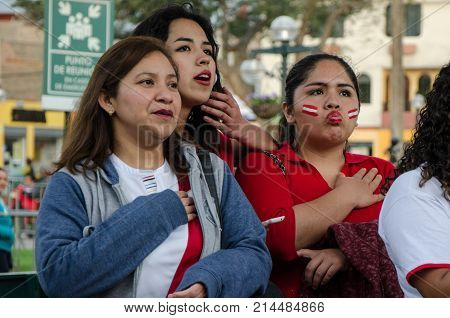 Lima, Peru - OCTOBER 10th 2017: Fanaticism in Peru (Peru vs Colombia) Russia 2018 . Patriots intoning the National Anthem hours before the match between Peru and Colombia