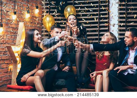 Cheers! Group Of Friends Clinking Glasses Of Champagne During Party Celebrating