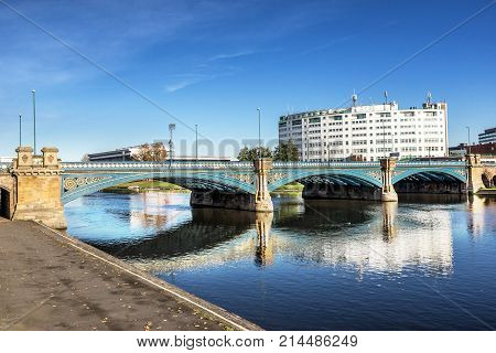 Looking across the river Trent to Trent Bridge in Nottingham