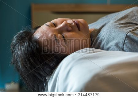 Asian Woman Take A Nap Or Sleep On Bed In Bedroom