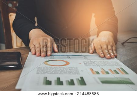 Asia Businesswoman Presenting Graph Analysis Documents Paper