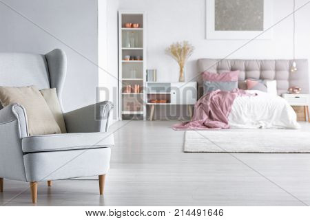 Open Bedroom With Stylish Armchair