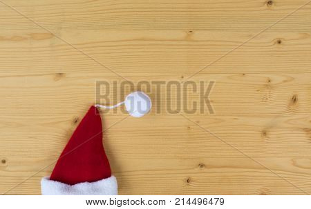 Simple santa hat on wood, christmas card
