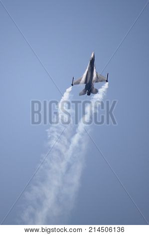 ROME - JUNE 29: A F-16 Fighter Falcon performs at the Rome International Air Show on June 29 2014 in Rome Italy