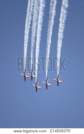 ROME - JUNE 29: The spanish acrobatic team Patrulla Aguila perform at the Rome International Air Show on June 29 2014 in Rome Italy