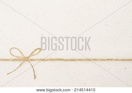 Cardboard Paper Background with Bow Rope Carton Texture and Vintage Twine Ribbon Knot