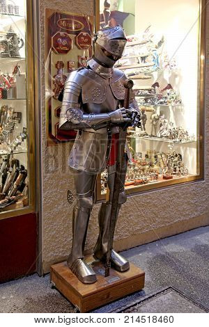 SALZBURG, AUSTRIA - JANUARY 5, 2013: Dummy in knight armor with sword standing outside souvenir shop in Salzburg, Austria. Antique knight armor mannequin.