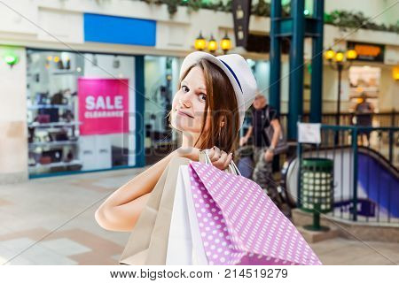 Fashion Young Girl Portrait. Beauty Woman With Craft Paper Bags In Shopping Mall. Shopper. Sales. Sh