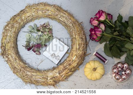 wreath, pink baubles, roses and silver gift box and pumpkin baby boo for the preparation of Christmas garland