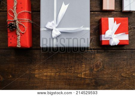 gift order composition holidays wooden background concept. creative present giving for family on birthday, new year, valentine's day, christmas and other occasion.