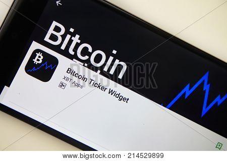 Berlin Germany - November 19 2017: Bitcoin Ticker Widget application on screen of modern smartphone close-up. Bitcoin Ticker Widget app in Play Store.