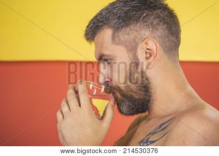 Man With Beard Hold Water Glass On Blue Background, Headache.