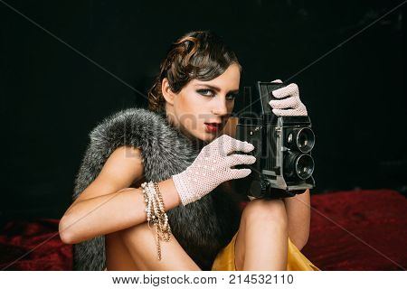 media and new technology journalism. Girl with vintage photo camera. beauty retro look pinup fashion. Pin up pretty fashion model photographer. Woman with retro hair makeup and old camera. poster