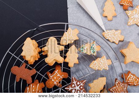 Idea DIY Do it yourself new year and Christmas gift concept butter sugar cookies with royal icing decoration in green bucket with copy space