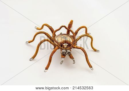 Metal spider with built-in clockwork on white background steampunk style close-up