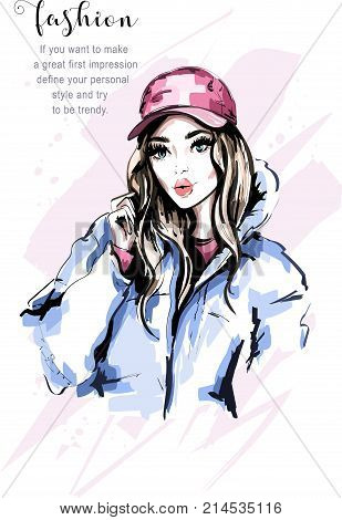 Hand drawn beautiful young woman portrait. Fashion woman in cap. Stylish cute girl with long hair. Fashion model in winter clothes. Sketch.