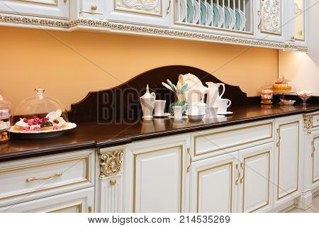 Interiors of kitchen with utensils for tea drinking