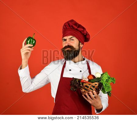 Vegetarian Restaurant Concept. Man With Beard On Red Background.