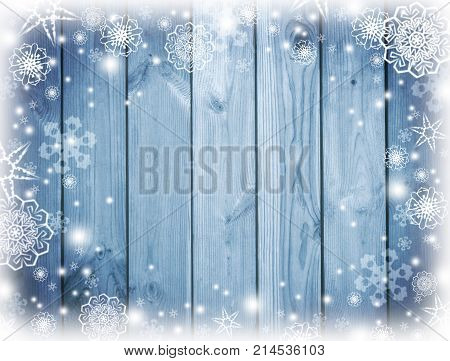 Blue christmas background.   New Year Frame for your text. Winter. Snowy Plank With Wintry  Background. blue wooden snowy background. top view.