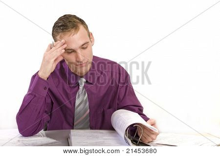 Businessman At Desk Thinks.