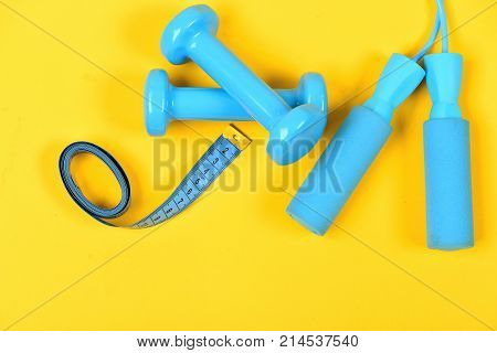 Barbells And Skipping Rope Next To Measure Tape Roll