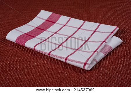 Background For Product. Checked Tablecloth In A Red And White Cage On Textured Surface, View From Ab