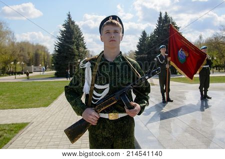 Yoshkar-Ola, Russia - April 30, 2016 A young cadet holds a submachine gun in the Shpagin system during a guard of honor in the central park of Yoshkar-Ola, Russia