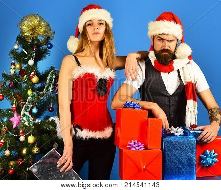 New Year And Christmas Time. Man With Beard And Woman