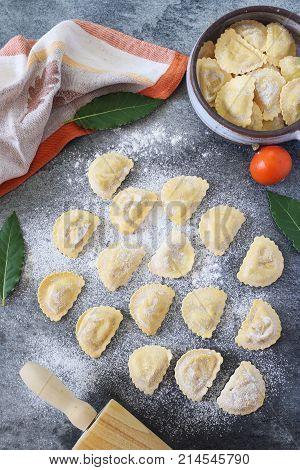 Italian Cuisine. Pumpkin and ricotta raw ravioli. Top view