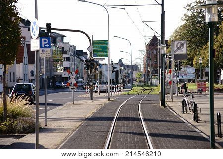 GRIESHEIM, GERMANY - OCTOBER 31: The main road in Griesheim with tram rails as well as residential and commercial buildings on October 31, 2017 in Griesheim.